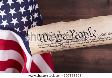 We The People, preamble to the United States constitution, with the American flag in background #1078383284