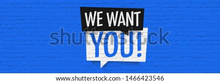 Photo of  We want you !, on speech bubble on brick wall banner