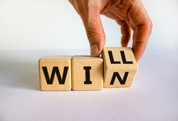 We will win symbol. Businessman turns cubes and changes the word will to win. Beautiful white background, copy space. Business, motivational and we will win concept.