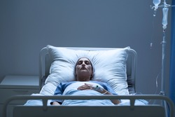 Weak woman with cancer dying alone during chemotherapy