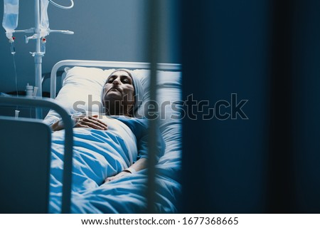Weak woman with cancer dying alone in hospital bed Stock foto ©