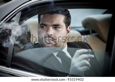 wealthy man in the back seat of a car stock photo 91019402