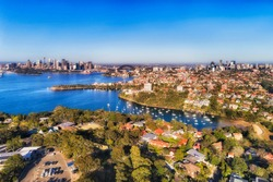 Wealthy Sydney suburb Mosman on Lower North shore of Sydney harbour in elevated aerial view from Taronga zoo towards city CBD landmarks.