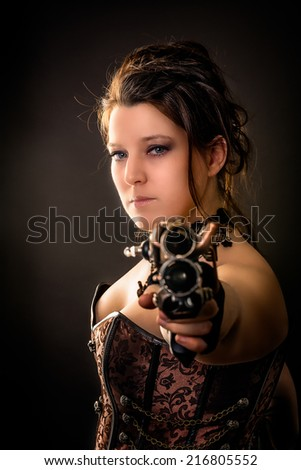 weapon girl woman in steam punk outfit aiming with a gun in the camera