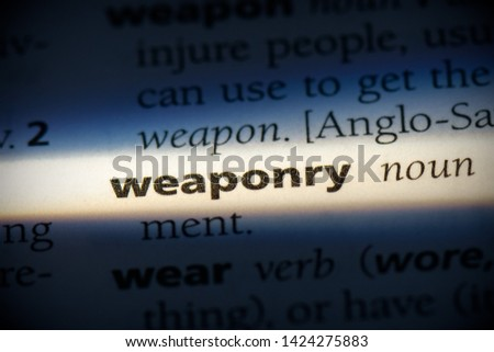 Photo of  weaponry word in a dictionary. weaponry concept, definition.