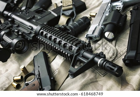 Weapons and military equipment for army, Assault rifle gun (M4A1) and pistol on camouflage background.