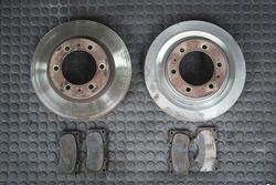 Wear ,Damage on the brake disc rotors surface and worn car brake pads.