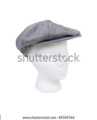 Wearing a masculine tweed flat driving cap worn on the head when out for a drive - path included