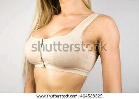 Wearing bra. Close-up of women wearing bra beautiful part of female body. a83652ac7