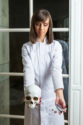 Wearing doctor's overall medical attendant gives medicines and cranium