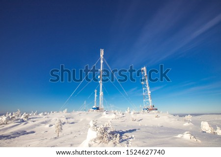 Weather meteorological station North, antennas in snow, blue clear sky. #1524627740