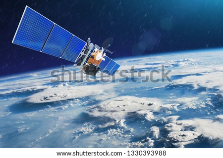 Weather satellite for observing powerful thunderstorms of storms and tornadoes in space orbiting the earth. Elements of this image furnished by NASA. #1330393988