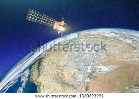Weather satellite over the desert drought in Earth orbit. Elements of this image furnished by NASA.