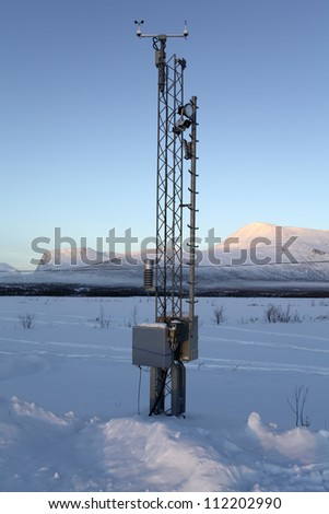 Weather station in snowy landscape