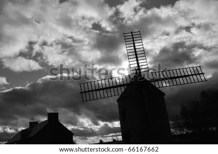Weathercock of vintage wind mill in Brittany, France