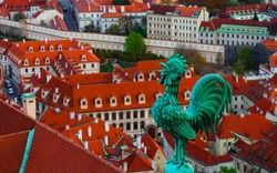 Weathercock on the roof, Czech, Prague, city view. Prague architecture, red roofs, weather vane shape of rooster.