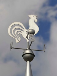 Weathercock on the roof of a building for wind measurement