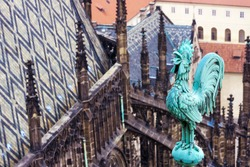 Weathercock on the St Vitus cathedral roof, Czech, Prague. Prague architecture, red roofs, weather vane shape of rooster.