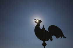 weathercock with a sunny eye