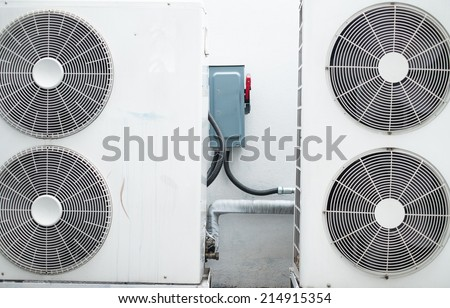 weathered air compressor and pipe of air conditioners outdoor with breaker