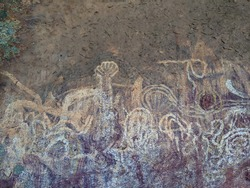 Weathered and damaged finger drawings done by the ancestors of Australian Aboriginals.  Recorded to be over 10,000 years old or older.