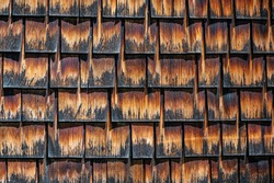 weathered and old appearing shingles on a roof