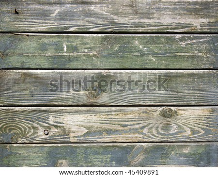 Weathered and scratched wooden plank
