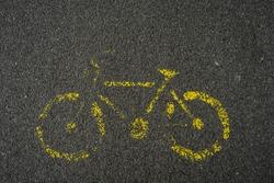 weathered bike roadsign on the ground