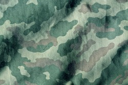 Weathered camouflage cloth texture. Abstract background and texture for design
