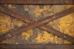 weathered cross steel on yellow iron door
