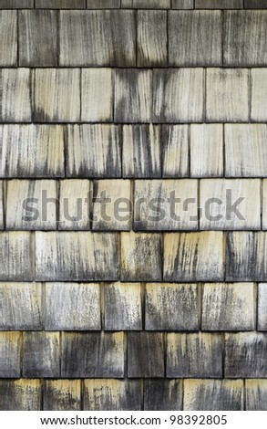 Weathered cypress shingles on outdoor wall of coastal building, for texture or background