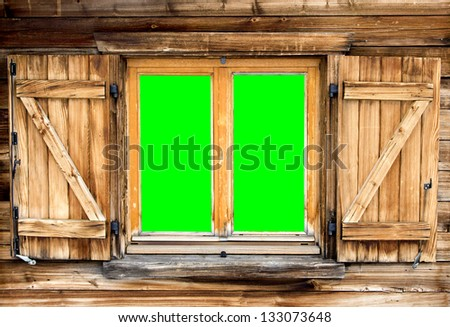 Weathered  facade of a mountain hut with green screen background