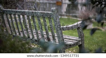 Weathered garden bench. #1349517731