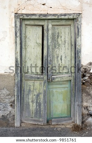 Weathered green door in a house in Haria, Lanzarote, Canary Islands, Spain
