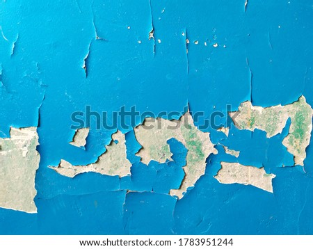Weathered home wall with peeling paint on plaster, with copyspace. Home remodeling. Damaged plaster on wall painted in blue color.  Photo stock ©