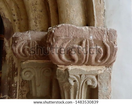 Weathered medieval column capitals with stone carvings in shape of leaves, close, up, Vianden castle, Luxembourg #1483530839
