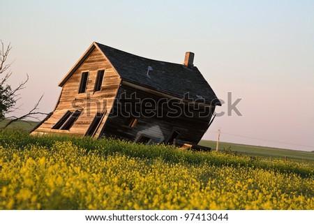 Weathered old farm house in scenic Saskatchewan - stock photo