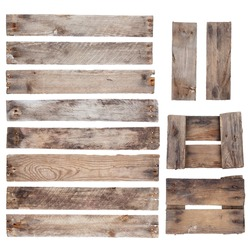 Weathered old wooden planks with rustic nails isolated on white background
