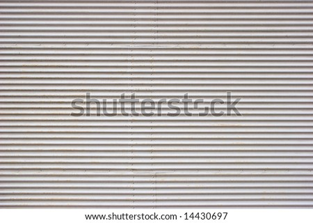 Weathered painted corrugated metal sheet texture background