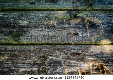 Weathered Picnic table top etched by vandals #1124345960