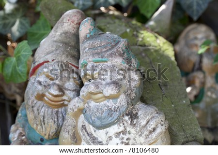 weathered retro garden decoration with garden gnomes