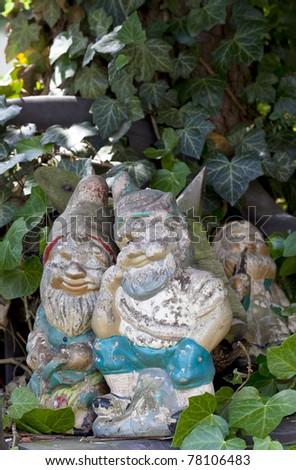 weathered retro garden decoration with garden gnomes