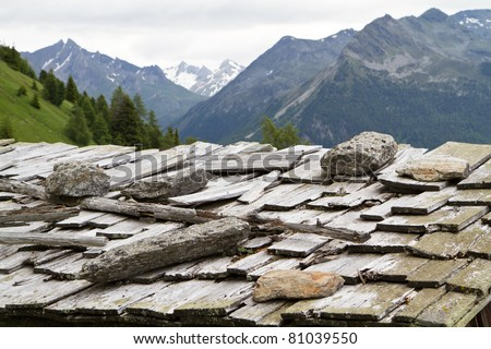 Weathered shingle roof in the Italian alps