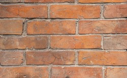 Weathered stained old brick wall background. grange