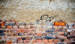 Weathered stained old brick wall background image