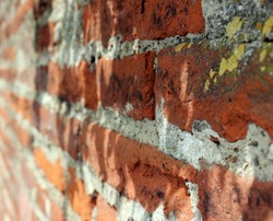 Weathered stained old brick wall beautiful background.