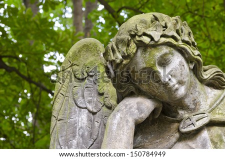 weathered statue of an angel  ...