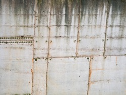 Weathered surface of concrete block wall.