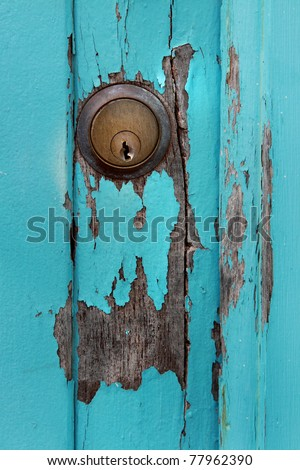 Weathered turquoise door with flat key lock