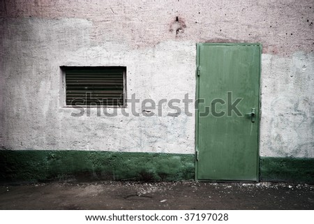 weathered wall with green door in grunge style